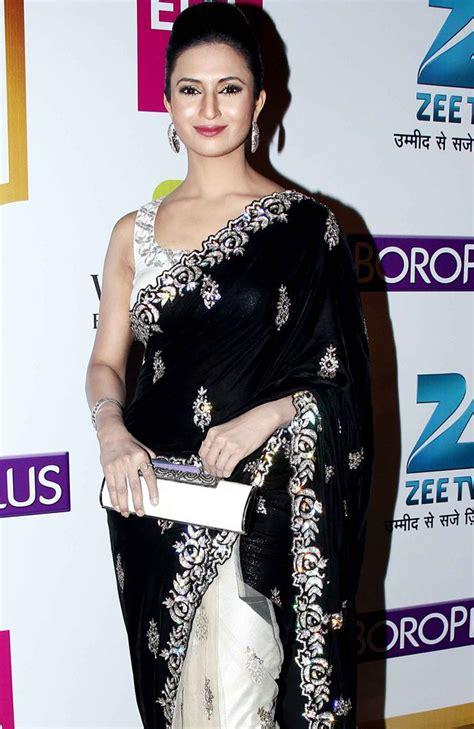 Hamidah Dress Black 1 divyanka tripathi poses in a black and saree at gold