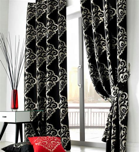 in a white room with black curtains black and white living room curtains