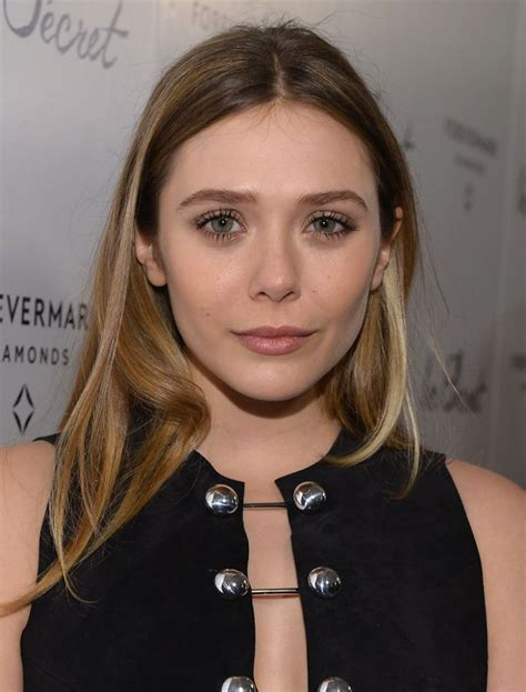 shaping hair tattoos safiya s house of kreation elizabeth olsen at quot in secret quot premiere in hollywood