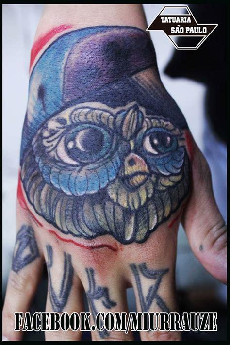 hand tattoo etiquette owls hand tattoo by miurrauze on deviantart