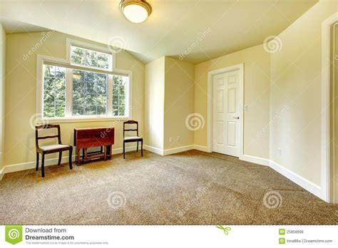 brown yellow walls empty room with yellow walls and brown carpet stock photo