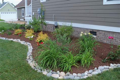 river rock flower bed 20 rock garden ideas that will put your backyard on the map