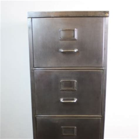 mid century polished steel filing cabinet with metal