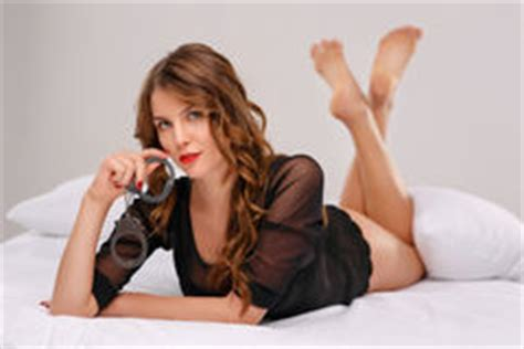 how to use handcuffs in bed sexual young woman locked in handcuffs stock image image 64708503
