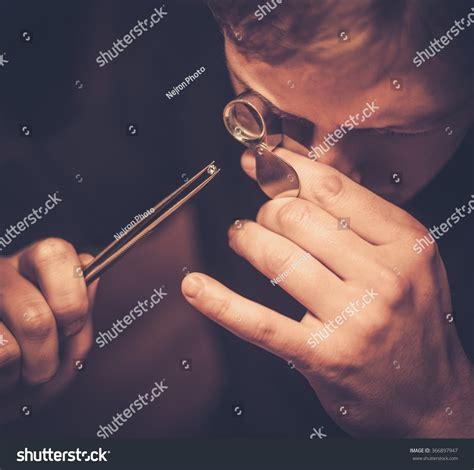portrait jeweler during evaluation jewels stock photo 366897947