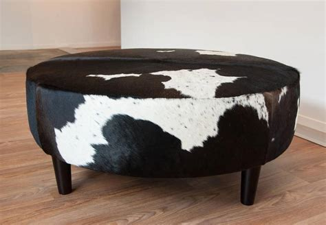 cowhide ottomans round ottoman chocolate white cowhide ottoman with wood legs