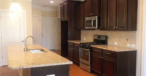 kitchen outlets reved the kitchen connoisseur kitchen with lowered bar timberlake scottsdale cherry