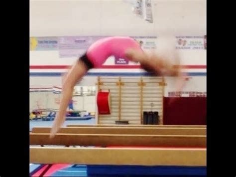 gymnastics back handspring layout stepout back handspring step out on balance beam tutorial with