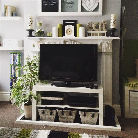 putting a tv in front of a window living room reveal a splash of green grillo designs