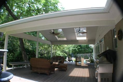 white patio cover with skylights and ceiling fans patio