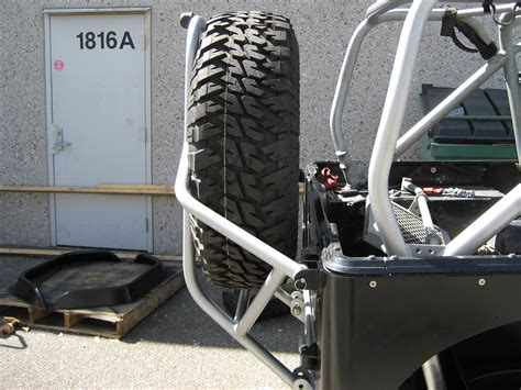 swing down tj lj swing down rear tire carrier steel genright jeep