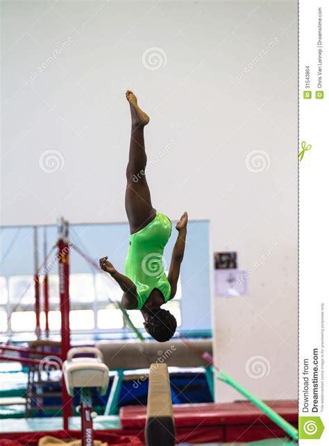gymnastics beam flip arial courage editorial stock