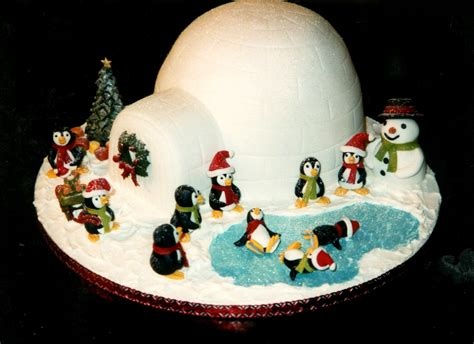 Sports Themed Cake Decorations - skating penguins with igloo christmas cake 171 susie s cakes