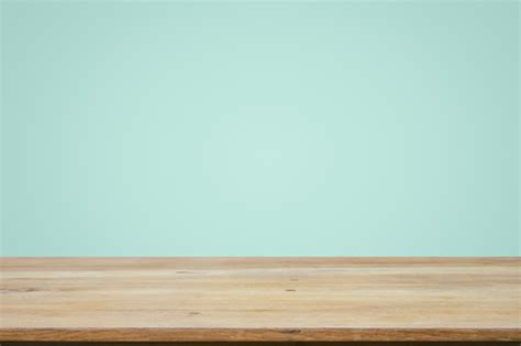 empty wooden deck table  mint wallpaper background