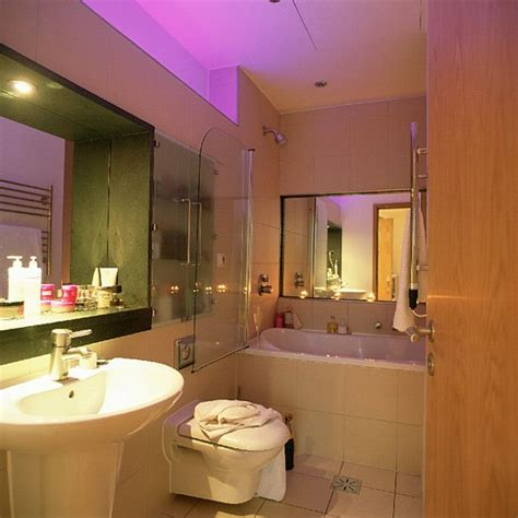 Space Saving Bathroom Ideas | small bathroom with white suite and mirrors housetohome