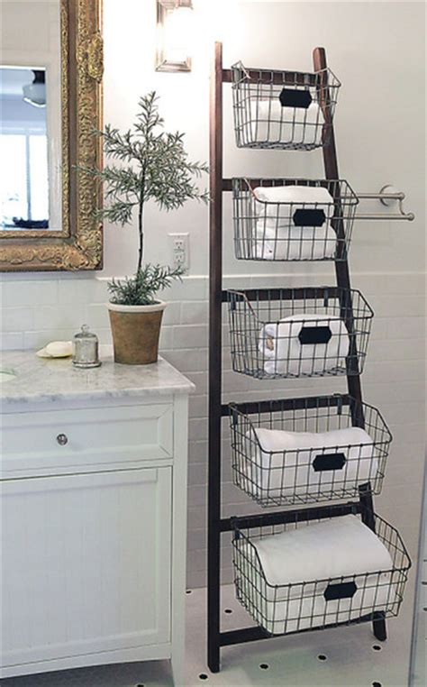 bathroom storage shelves with baskets wood ladder with 5 wire baskets eclectic bathroom