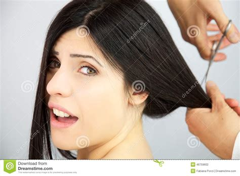 video on cutting long hair into a short shag doing it yourself woman surprised about getting long hair cut stock photo