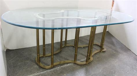 brass and glass dining table oval glass and brass dining table by mastercraft at 1stdibs