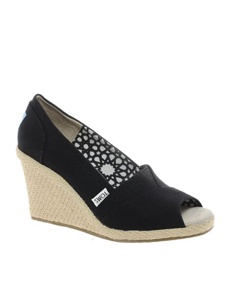 toms canvas wedge heeled shoes in black lyst