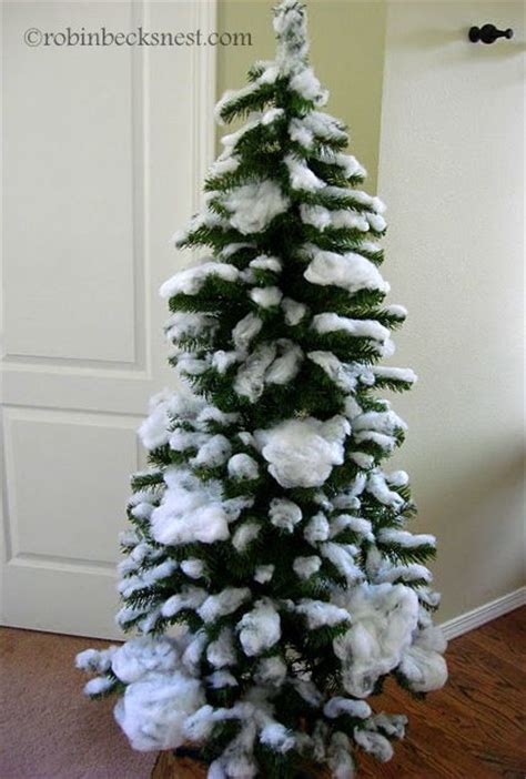 photos of atrificial christmas tress with snow how to flock a tree with poly batting today s craft and diy ideas nests