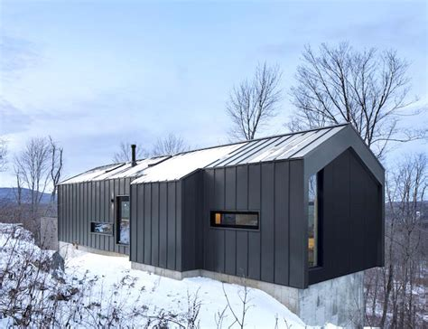 Steel Cabins by Minimalist Steel Cabin Floats Above A Rugged Slope In