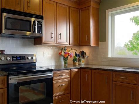 quartz countertops with maple cabinets black quartz countertops white subway tile backsplash