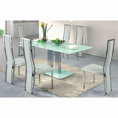 extending dining table set in clear glass with 6 z