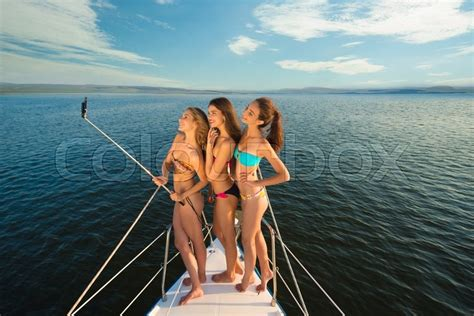 yacht girls girlfriends rest on a yacht in the middle of the ocean