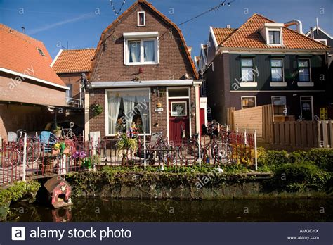 buy a house in holland front yard of a dutch house near the town of vollendam in holland stock photo royalty