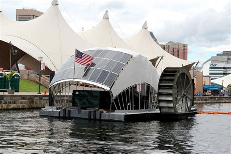 trash boat water mr trash wheel baltimore waterfront