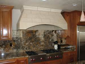 Alder kitchen view of custom cultured kitchen hood and full granite