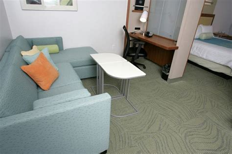Relaxing Desk Items by Our Spacious And Comfortable Suites Feature Separate Areas