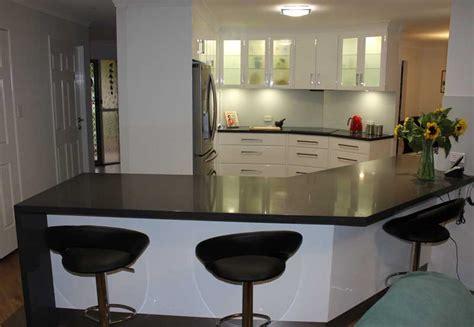 kitchen renovation brisbane with caesarstone benchtops and white macubus quarzite slate grey and gloss white galley kitchen kitchen