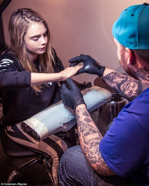 hand tattoo initials cara delevingne has her initials etched onto her hand just