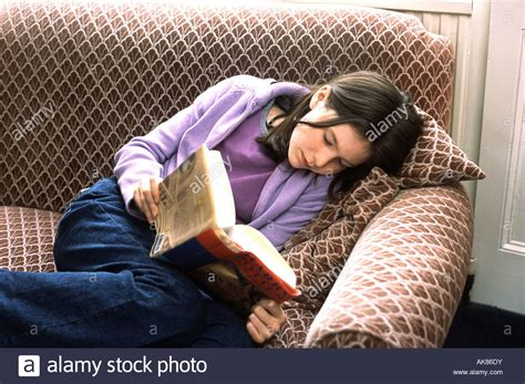 Curled Up On The by 12 Year Reading A Book Curled Up On The Living