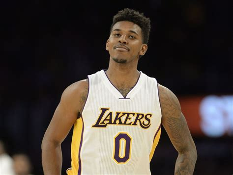 nick young tattoos photos swaggy p gets 2pac on right arm once