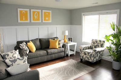 dark gray couch  yellow throw pillows  yellow