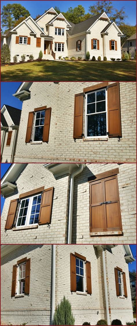 stained brick house custom built and stained exterior cedar shutters on white brick house exterior