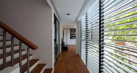 clever use of louvers and a neutral color scheme transform