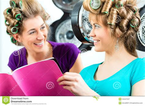 Hair Dresser Reading by At The Hairdresser With Hair Dryer Royalty Free Stock Photography Image 34447047