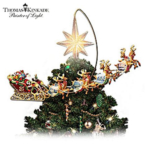 kinkade holidays in motion rotating illuminated tree topper animated decor