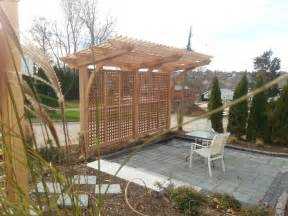 cantilevered pergola cedar structure with mahogany lattice work don t really dig the lattice