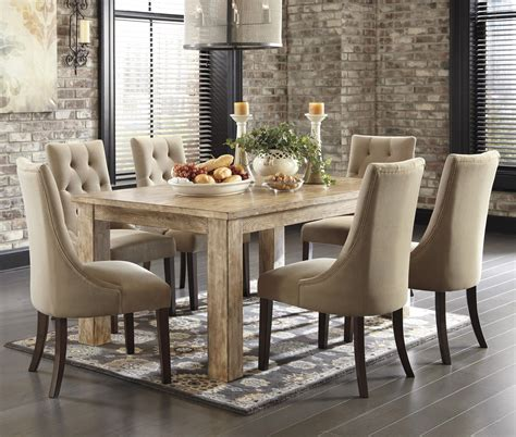 7 piece dining set with upholstered side chairs by