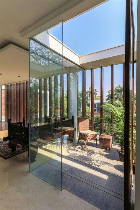 wooden slats glass walls  modern grandeur gallery house  india