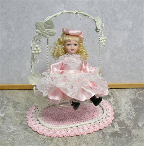 porcelain doll on swing bisque porcelain dolls s creations collections