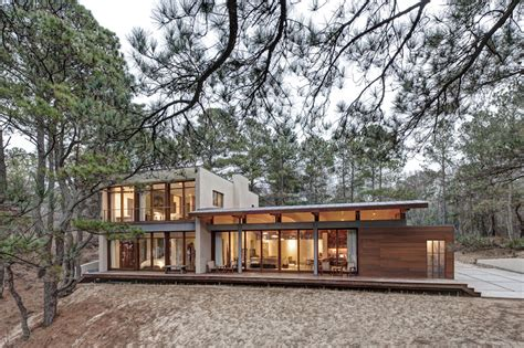 house 2 home design studio contemporary forest house with curved metal roof modern