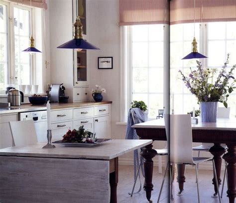 Adding Color To A White Kitchen by Cobalt Blue In The Glass Lshades And The Ceramics