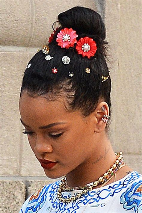 rihanna curly teased dark brown bun hairstyle steal her
