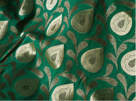 Floral In Green silk brocade fabric in green and gold floral pattern