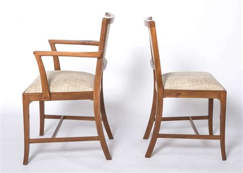 a set of eight yew dining chairs by heal and sons of